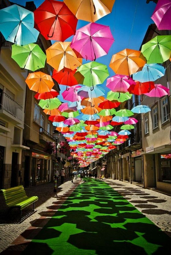 Colourful Umbrellas Over The Streets Of Portugal